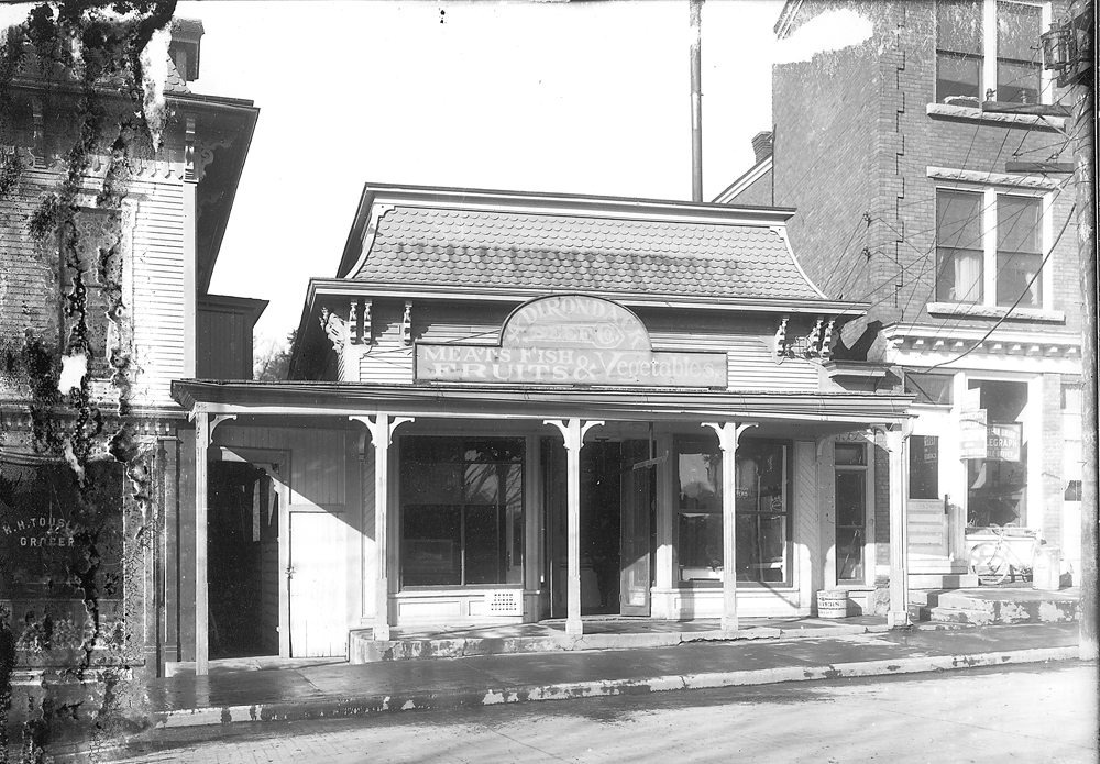 Gibney's Market, earlier the Franklin County Library, and current site of Post Office Pharmacy (Photograph #81.305 courtesy of the Adirondack Collection, SLFL)