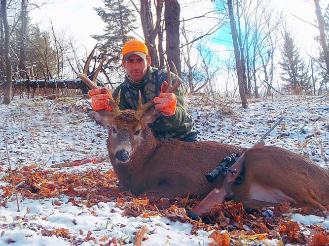 Wilmington-based guide and hunter Peter Price displays a big buck he shot in the northern Adirondacks. (Provided photo — Pete Price)