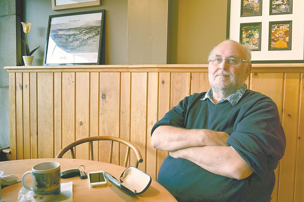 Ian Orme, recently honored for his groundbreaking studies of tuberculosis, sits in the Blue Moon Cafe in Saranac Lake Wednesday. (Enterprise photo — Glynis Hart)