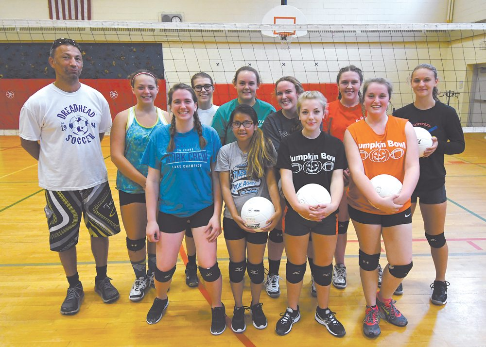The Saranac Lake volleyball team, front row from left: Hannah Gochenaur, Holly Kurtz, Sydney Andronica and Kelsey McCarthy. Back row: Coach Mike Navarra, Nora Glover, Kaity Burat, Katie Gay, Madie Gay, Danielle Gonyea and Marissa Gibbs. (Enterprise photo — Lou Reuter)