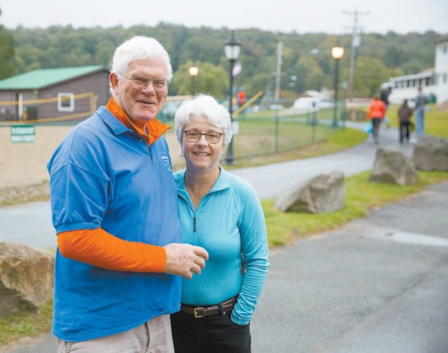 Charles and Sue Bolesh smile Friday in Old Forge at the start of the 90-mile Adirondack Canoe Classic, where they are celebrating their 50th anniversary as volunteers. They've celebrated every anniversary since their 25th at the canoe and kayak race. (Photo provided — Mike Lynch)