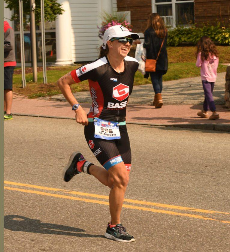 Elizabeth Izzo, of Lake Placid, runs during Sunday's Lake Placid Ironman 70.3. (Enterprise photo — Lou Reuter)