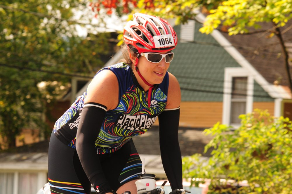 Sara Cook, of Lake Placid, picks up speed toward the end of the 56-mile bike course Sunday. (Enterprise photo — Morgan Ryan)