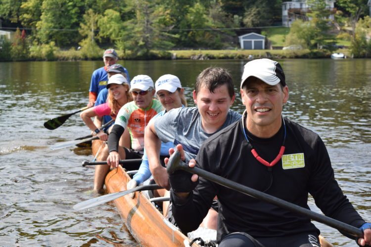 After three days of battling it out during the Adirondack Canoe Classic with boat 12, boat 13 jetted across the finish line Sunday in first place. Ross's Rockets included Peter Ross, Michelle Weiler, Tim Henning, Francis Echliman, Mike Skivington, Jill Skivington Jackett and Richard Neugebauer. The 90-mile canoe race ended Sunday in Saranac Lake.  (Enterprise photo — GlynisHart)