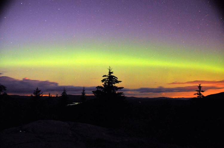The Northern Lights are seen from Coney Mountain outside Tupper Lake Thursday night. (Photo provided —Ted Merrihew)