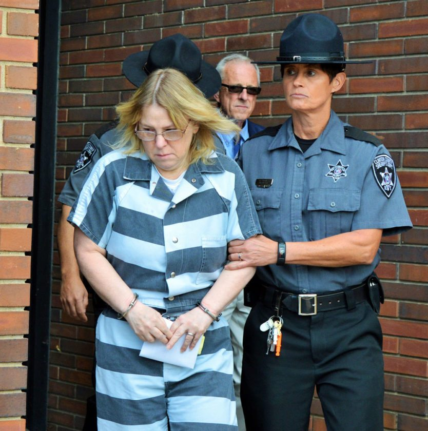 Joyce Mitchell, wearing striped jail inmate's clothing, exits the Clinton County  courthouse in Plattsburgh after a sentencing hearing in September 2015. (Photo provided — Jason Cerone)