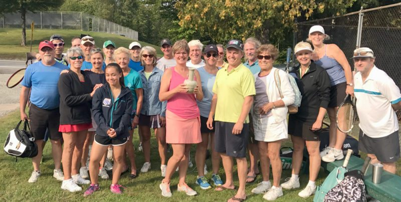 "Participants in the Lake Placid-Saranac Lake Tennis Challenge pose for a photo at Whiteface Tennis Center in Lake Placid following play on Monday, Sept. 4. The third annual challenge consisted of six mixed doubles teams from the villages of Saranac Lake and Lake Placid squaring off for bragging rights and the presentation of the, ""coveted Tennis Trophy, emblematic of some tennis superiority in the North Country."" Saranac Lake amassed 88 total games won to earn the victory over Lake Placid, which finished with 69 games won. It was the second year in a row that Saranac Lake won the Challenge. Beth and Ron Edgley again garnered the most games won for Saranac Lake with 21. Ikuo Toishi and his daughter Sonja Toishi were the big earners for Lake Placid with 20 wins. Other teams for Saranac Lake were George Stauffenberg/Gina Dumnd, Henry and Jessie Jacobe, Julie Weinstein/Mark Coleman, Kate Hale/John Mathiason and LeeAnn Baker/Tyler Chase. Lake Placid players were Jennifer Ledger/Jim Cushman, Pam Smith/Rich Cotton, Mike Sorel/Judy Borzilleri and Kyle Woodleif. 	 (Photo provided)"