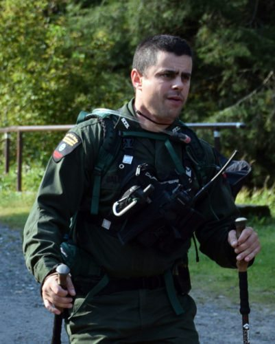 Forest Ranger Adam Baldwin walks out of the woods Sept. 4 after searchers found a missing hiker that morning near St. Regis Mountain in Paul Smiths. (Enterprise photo — Justin A. Levine)