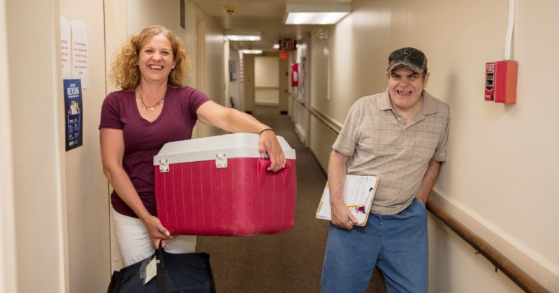 Direct Support Professional Tami Cooke works with James Manning, who likes to help others — whether it's sharing a smile or holding a door. One of the ways he participates in the community is by volunteering for the Meals On Wheels program through the Malone Adult Center. (Photo provided)