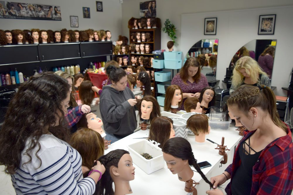 Darcy Burman's cosmetology classroom that will be expanded if the capital project gets voter approval. From left to right: Rose Burns, Kayley LaPierre, Morgan Streeter, Madison Vachon, Alyssa Whitney, Marissa Durham, and Kaylee Adams. (Enterprise photo — Glynis Hart)
