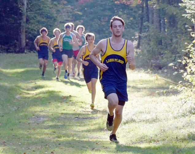 Lake Placid senior Scott Schulz leads a pack of runners during the first lap of Tuesday's cross country race at Mount Van Hoevenberg in Lake Placid. (Enterprise photo — Justin A. Levine)