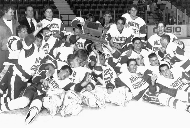 Members of North Country Community College men's hockey team celebrate after winning a national championship in 1995. (North Country Community College photo)