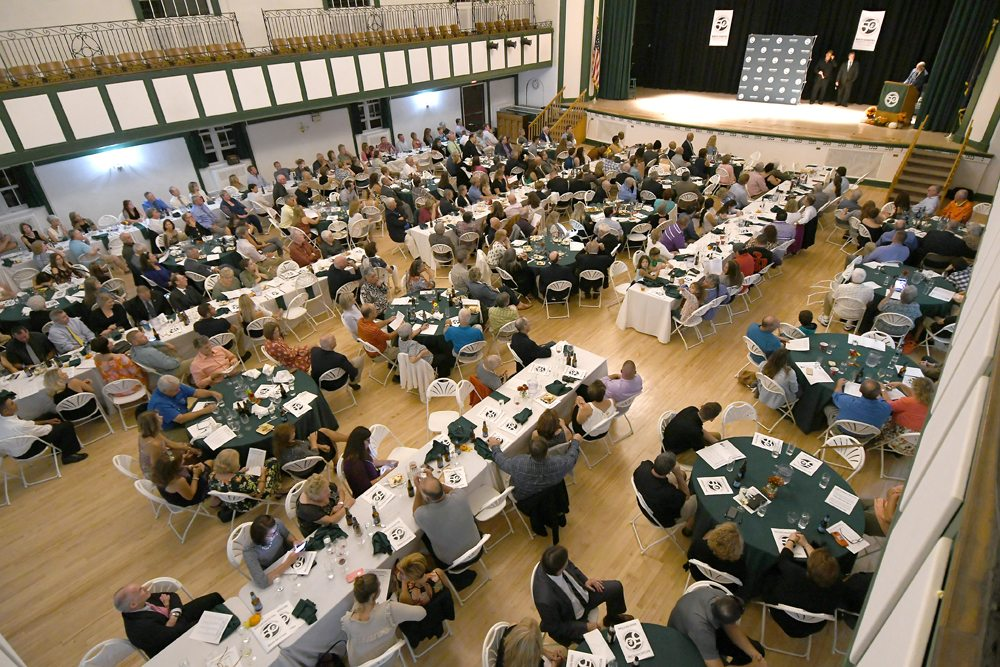 The NCCC athletics family gathered at Harrietstown town hall for Friday's Hall of Fame inductions. (Enterprise photo — Lou Reuter)