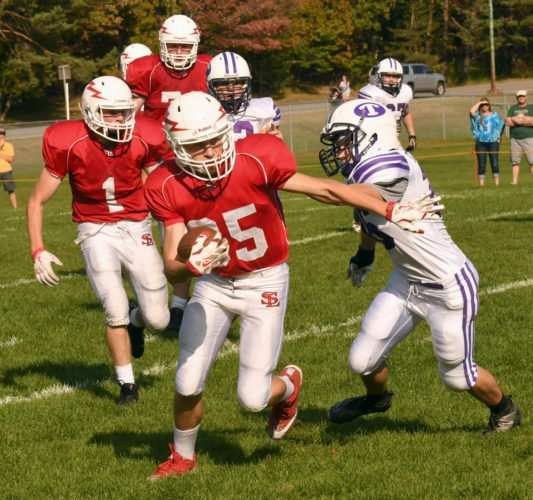 Saranac Lake receiver Kyle Lewis shakes away from a Ticonderoga defender while picking up 8 yards on a pass reception in the final period of Saturday's game. The senior scored later in the drive on a 40-yard catch on a ball thrown by quarterback Rhett Darrah. (Enterprise photo — Lou Reuter)