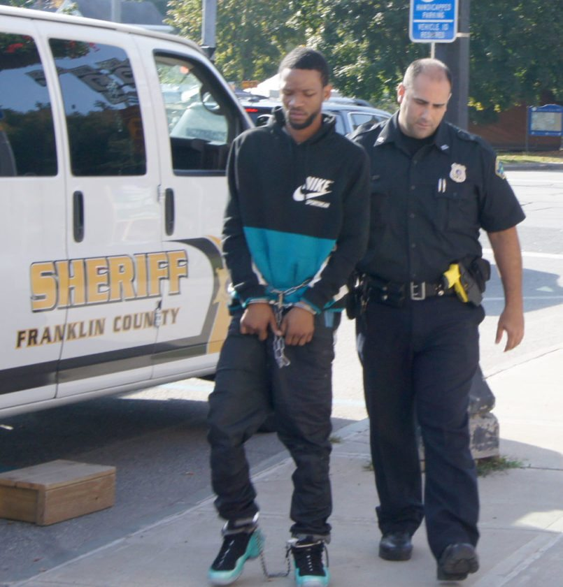 Laevon Cannon, suspecting of dealing drugs, is escorted from the Harrietstown Town Hall with Saranac Lake police Patrolman Travis MacDonald after being arraigned in town court. (Photo provided by Saranac Lake Police Department)