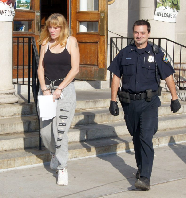 Jolene Tyler, suspecting of dealing drugs, is escorted from the Harrietstown Town Hall with Saranac Lake police Patrolman Jason Swain after being arraigned in town court. (Photo provided by Saranac Lake Police Department)