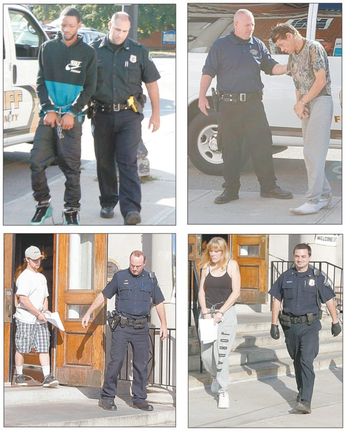 Clockwise, from left, Laevon Cannon, Leonard Bushey, Jolene Tyler and Seth Pickreign are escorted by members of the Saranac Lake Police Department during a drug bust Saturday. (Photos provided by Saranac Lake Police Department)