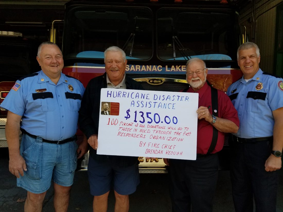 Proceeds from the Teddy Roosevelt Show on Sept. 19 in Saranac Lake were donated to hurricane relief efforts, and presented to Chief Brendan Keough, far right, and Assistant Chief Tim Donaldson, far left, by Bob Brown, second from right, and Joe Spadaro. Relief will be sent  directly to fellow first responders in the affected areas. Heartfelt thanks to all who helped. (Photo provided)