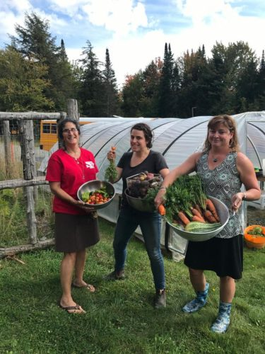 Saranac Lake Central School Food Service Director Ruth Pino, left, Farm to School Coordinator Zohar Gitlis, center, and Shannon Bartholomew pose with locally harvested vegetables for the school.  (Photo provided)