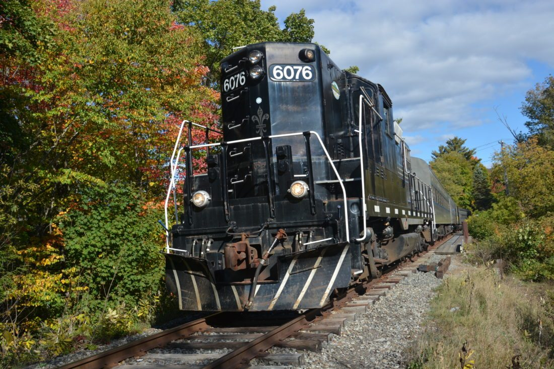 The Adirondack Scenic Railroad makes its way along the tracks near Saranac Lake in October 2016. (Enterprise photo — Lou Reuter)