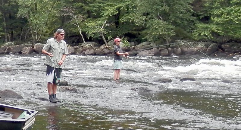 Flyrodders work their craft on a remote section of the Raquette River, where the tumbling waters provide plenty of oxygen, and plenty of fish. (Photo — Joe Hackett)