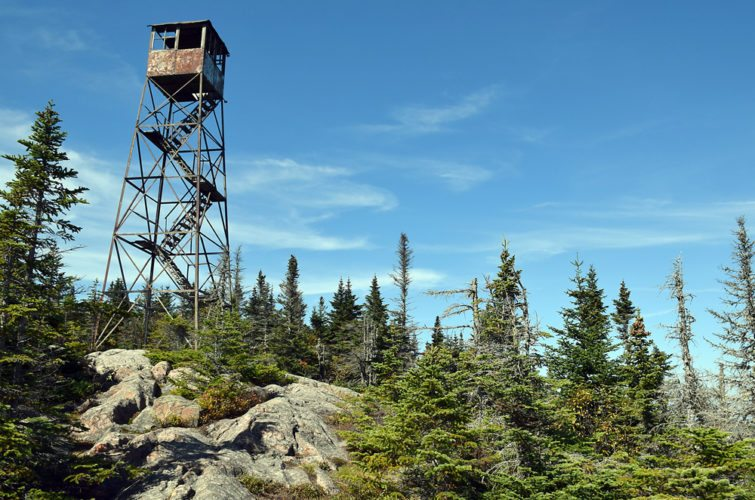 The summit of Loon Lake Mountain is about half open, offering views of the High Peaks. The tower, which is unsafe to climb and has the bottom set of steps removed, was originally installed in 1917, but was rebuilt in 1928 after being blown over in hurricane-force winds. (Enterprise photo — Justin A. Levine)