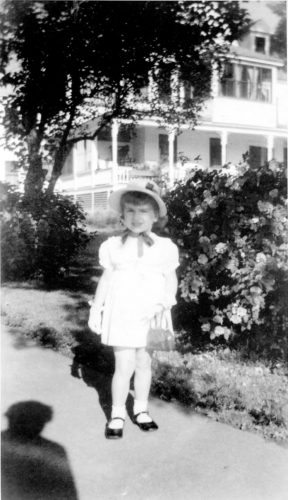"""The huge, three-story Gutshow cure cottage mentioned in today's column was at 1 Pine St., shown in the background of the picture of my niece Mary Ellithorpe Grady, my sister Marguerite's daughter. Mary was standing on the sidewalk leading into 5 Pine St., the home then owned by my parents Dennis and Elizabeth (Bessie Keegan) Riley. The other Gutshow cure cottage was at 71 Bloomingdale Ave., directly behind 1 Pine St. and where I began my career as a """"Tray Boy."""" Mary is now Mrs. Gary Grady of Wilmington and proud mother and grandmother."""