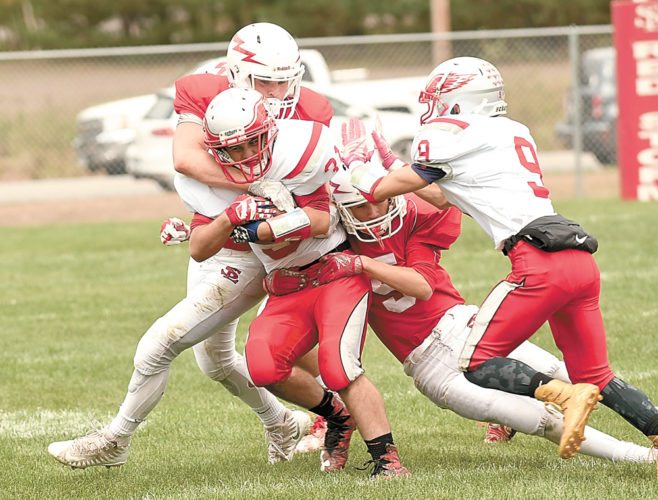 Saranac Lake's Jarrett Ashton and Ryan Meyer combine to tackle Beekmantown running back Trent Cook during the first half of Saturday's game. (Enterprise photo — Lou Reuter)