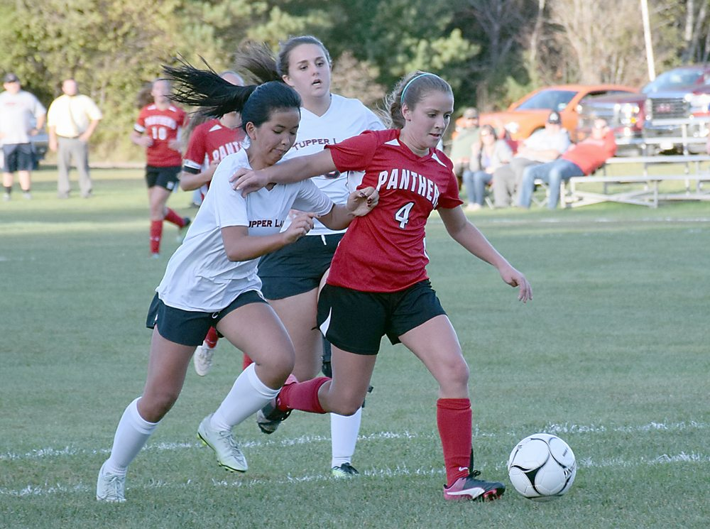 Brushton-Moira senior Kenna Tavernia, right, holds off Tupper Lake's Kate Harriman during Tuesday's game in Tupper Lake.  (Enterprise photo — Justin A. Levine)