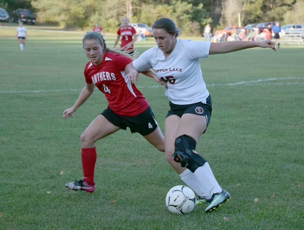 Tupper Lake junior Marah Liscum dribbles the ball around Kenna Tavernia, of Brushton-Moira, on Tuesday (Enterprise photo — Justin A. Levine)