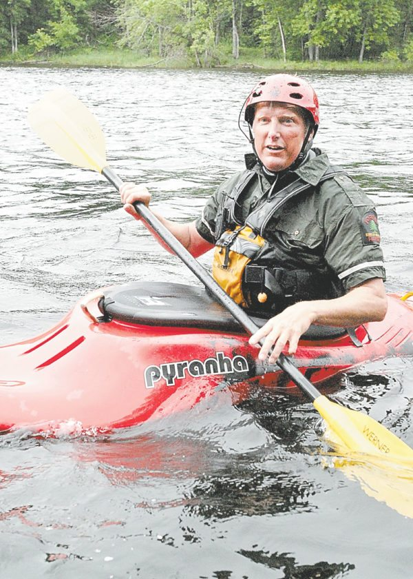 Forest Ranger Bruce Lomnitzer of Indian Lake, seen paddling a kayak, is one of the state Department of Environmental Conservation's 14 drone pilots. (Photo provided by DEC)