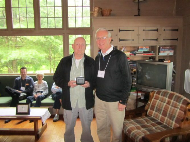 Mercy Care Board President  Jerry Hayes, right, presents the Volunteer of the Year Award to Paul Guerrette. (Photo provided)