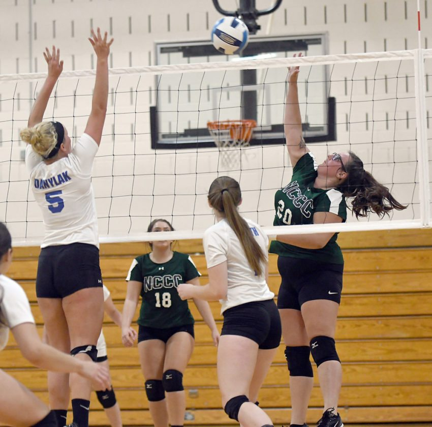 Katie Burgess, of Saranac Lake, sends the ball over the net for North Country while Fulton-Montgomery's Raina Danylak (5) and Gabrielle Smith defend during Wednesday's match in Saranac Lake. (Enterprise photo — Lou Reuter)