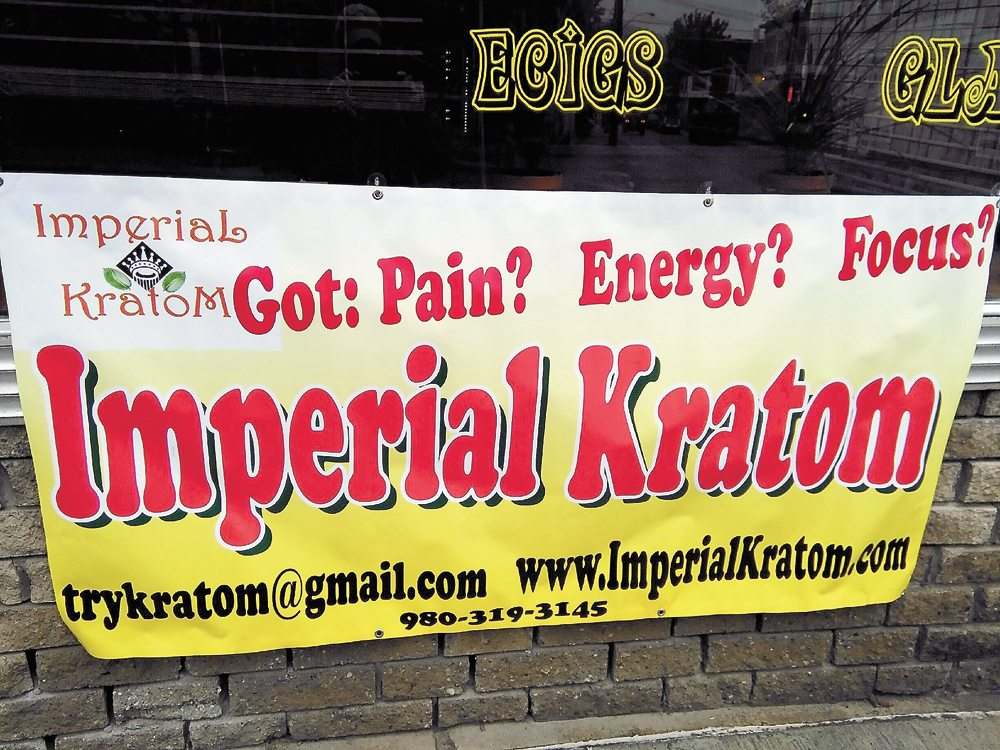 A sign in front of the former Saranac Lake head shop Grateful Toad advertises for an event in October 2015 when free samples of kratom were given out by the Imperial company. In 2016, the Grateful Toad was fined $12,000 for selling mislabeled kratom, and the shop was shut down later that year. (Enterprise photo — Morgan Ryan)