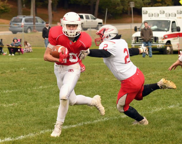 Sophomore Ben Munn, pictured carrying the ball on a kick return last week against Beekmantown, is expected to play a bigger role in Saranac Lake's offensive backfield with Jarrett Ashton out of the lineup. (Enterprise photo — Lou Reuter)