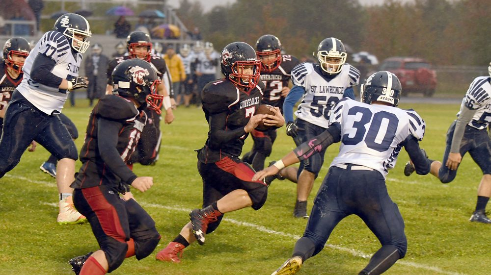 Tupper Lake junior Brennen McComber picks up yards during the second game of the season against St. Lawrence Central. McComber will be back in the lineup for the 'Jacks tonight after recovering from an injury. (Enterprise photo — Lou Reuter)
