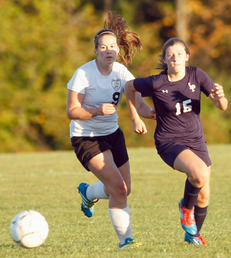 Lake Placid's Shannon Bentley and Elizabethtown-Westport senior Abby Mero chase the ball during Thursday's Northern Soccer League Division II matchup. Lake Placid came from behind to secure a 2-1 road victory. (Provided photo — Roy Bombard)