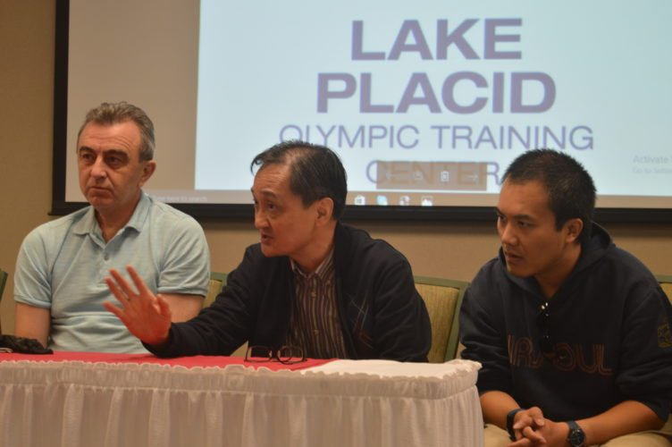 Yinchun Liu, the deputy secretary general of the People's Government of Beijing, right, speaks Thursday during a visit to the Lake Placid Olympic Training Center by several members of the World Union of Olympic Cities. (Enterprise photo — Antonio Olivero)