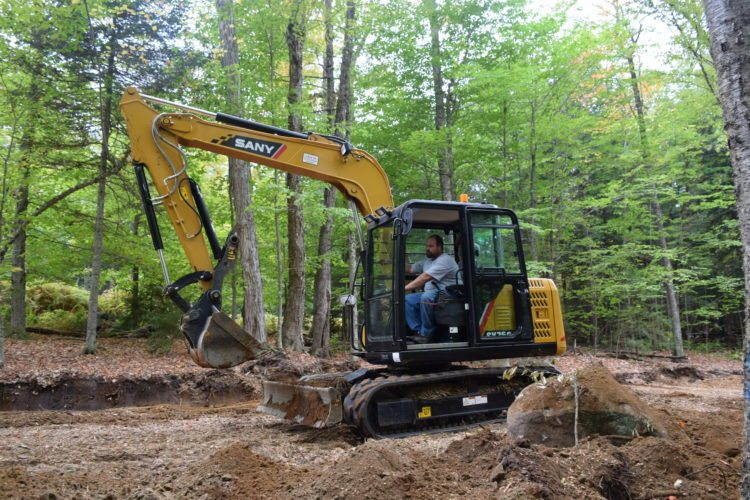 Joseph DeFuria of the Harrietstown Highway Department grades new ski trails at Dewey Mountain Recreation Center just outside Saranac Lake. (Enterprise photo — Glynis Hart)