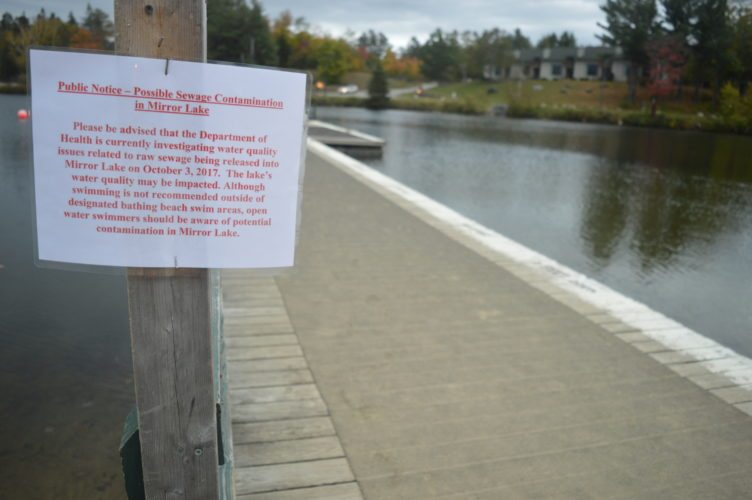 A sign posted at the Lake Placid village beach Wednesday informed people of a sewer leak and asks them to avoid swimming in the water. A day later, the state Department of Health gave the all-clear after judging Mirror Lake to be clean and safe. (Enterprise photo —  Antonio Olivero)