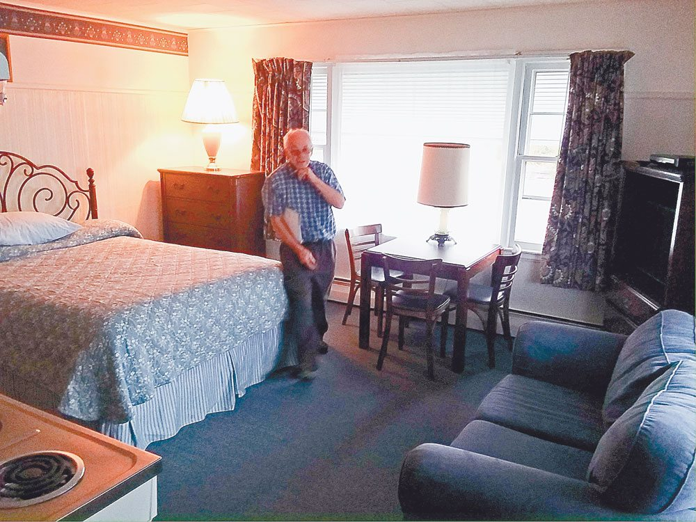 David Manning gives a tour of a room in his Lake Side Motel in Saranac Lake this week. (Enterprise photo — Glynis Hart)
