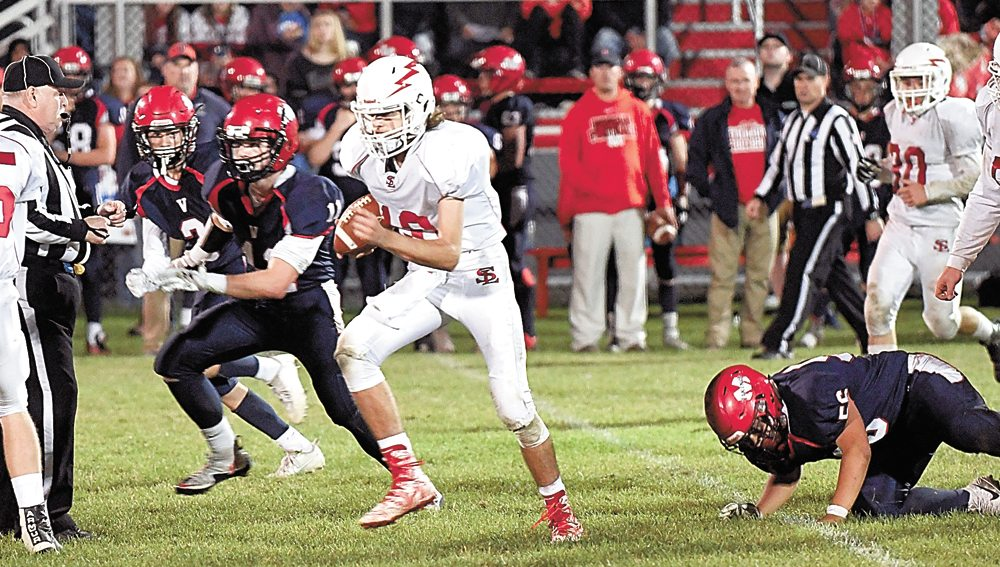 Saranac Lake freshman backup quarterback Rhett Darrah finds running room in the middle of the field during the final quarter of Friday's game at Moriah. The Red Storm lost 51-7 to fall to 1-5 on the season with one game remaining on their Champlain Valley Athletic Conference schedule. (Enterprise photo — Lou Reuter)