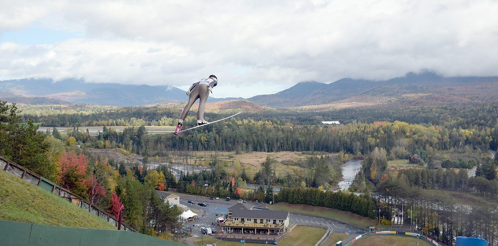 Lake Placid native Nina Lussi soars during the first of her two jumps that led to a US Ski Jumping national championship Sunday at the Olympic Jumping Complex in Lake Placid. (Enterprise photo — Justin A. Levine)