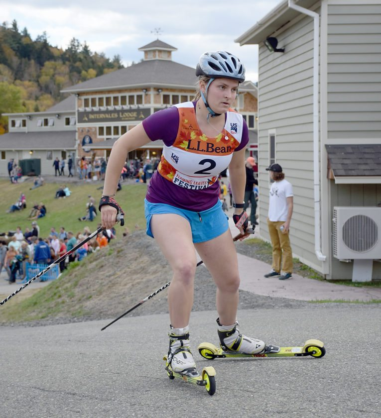 Lake Placid's Gabby Armstrong makes her way past the crowd Sunday at the Lake Placid Olympic Jumping Complex during the skiing portion of the nordic combined competition.  (Enterprise photo — Justin A. Levine)
