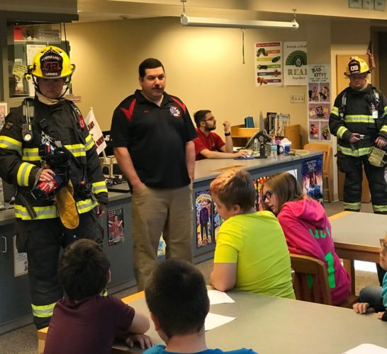 Members of the Tupper Lake Volunteer Fire Department spoke to L.P. Quinn Elementary School students Tuesday as part of the school's Fire Safety Week. Pictured are firemen, from left, Zach Larabie, Matt Boudreau and Josh Clement. (Photo provided — Tupper Lake Volunteer Fire Department)