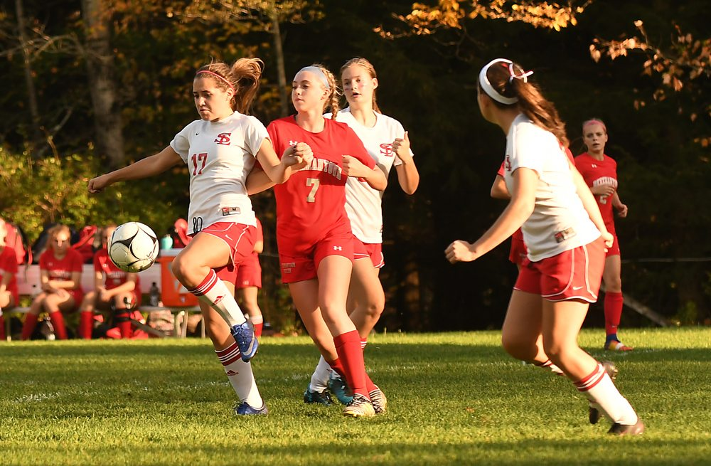 Lea Hill of Saranac Lake settles the ball in front of Beekmantown's Danielle Dyke during Tuesday's match. (Enterprise photo — Lou Reuter)