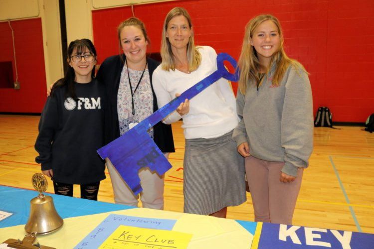 The Saranac Lake High School Club Fair was held in the gym during activity period on Sept. 11. Roughly 20 clubs were represented which gave students the opportunity to learn about different extracurricular activities they might like to participate in. Pictured are members of the Key Club: Karina Garcia, Mrs. Bluestein, Mrs Bell and Jenna Morgan. (Photo provided)