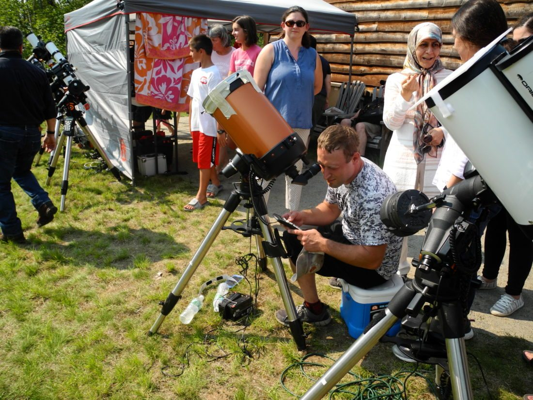 A man looks through a telescope in August as thousands flocked to the Adirondack Public Observatory to view the solar eclipse. The observatory has been named one of four local projects that are economic development priorities by the North Country Regional Economic Council, improving their chances for state grants in a contest between New York's various regions. (Enterprise photo — Aaron Cerbone)