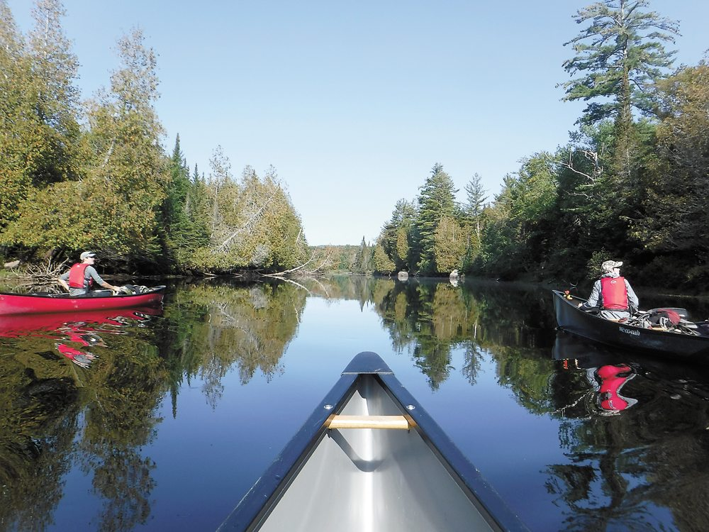 NCCC Wilderness Recreation Leadership students Henry Uzdavinis, left, and Julie Landry paddle on the Raquette River toward Stony Creek Ponds during the program's 30-day wilderness practicum. (Photo provided)