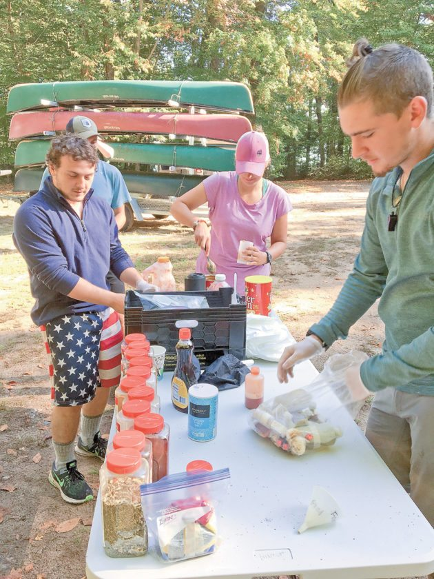 Students in North Country Community College's wilderness recreation program re-stock their food supplies as they transition from the paddling portion to the backpacking section of their 30-day practicum.   (Photo provided)